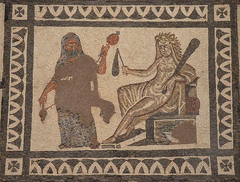 Héraklés v ženských šatech s přeslicí a vřetenem před královnou Omfalé, která je oděna do jeho lví kůže a v ruce drží jeho kyj. Mozaika ze 3. stol. n. l., Národní muzeum v Madridu. Zdroj: Wikimedia Commons.